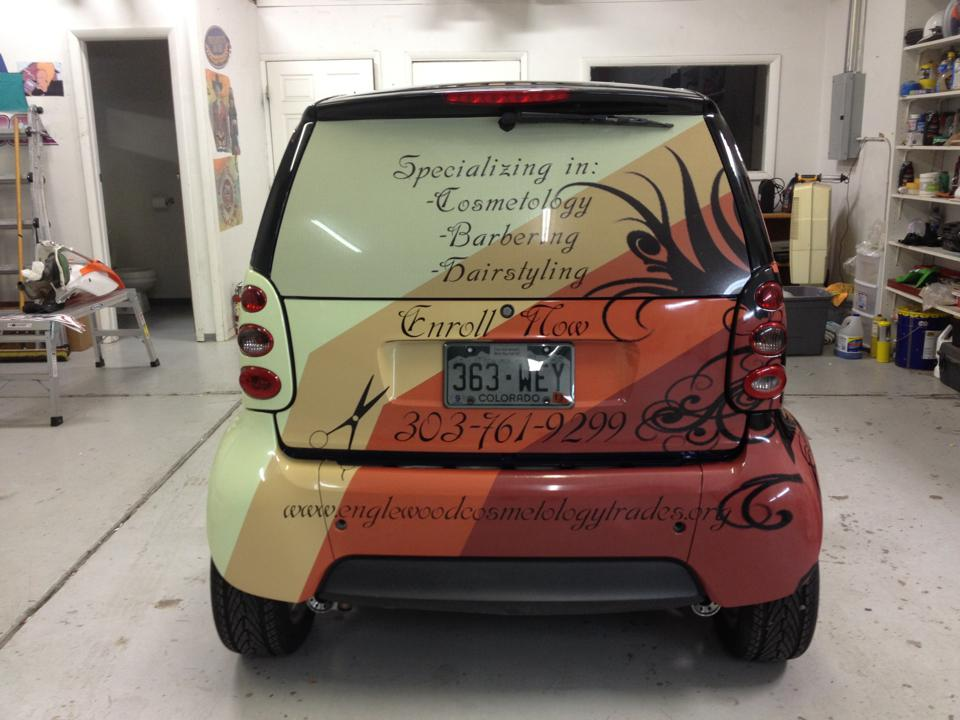 red and yellow smart car wrap