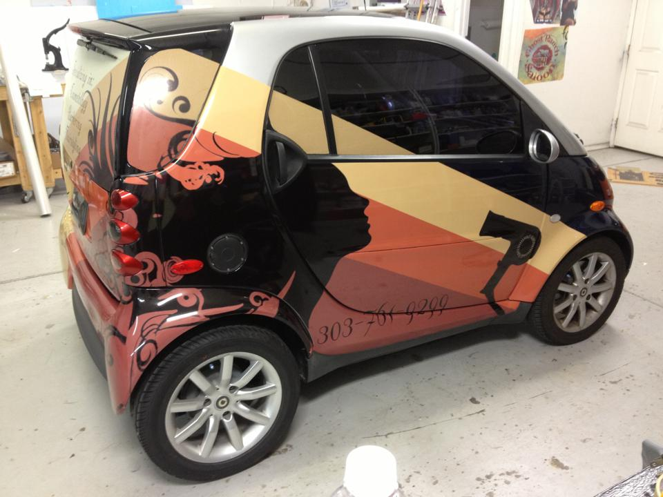 red and yellow smart car wrap side