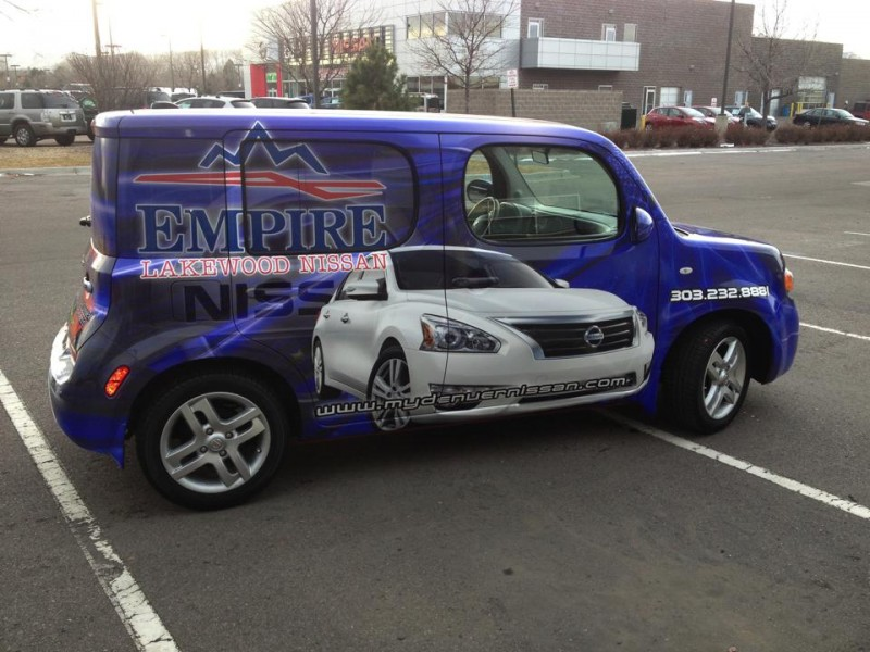 blue and silver Nissan wrap