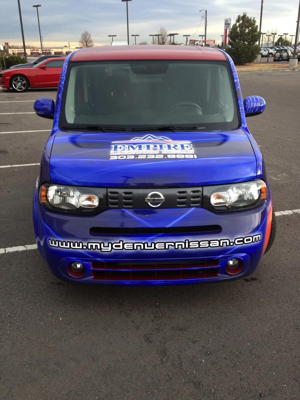 blue and silver Nissan wrap front