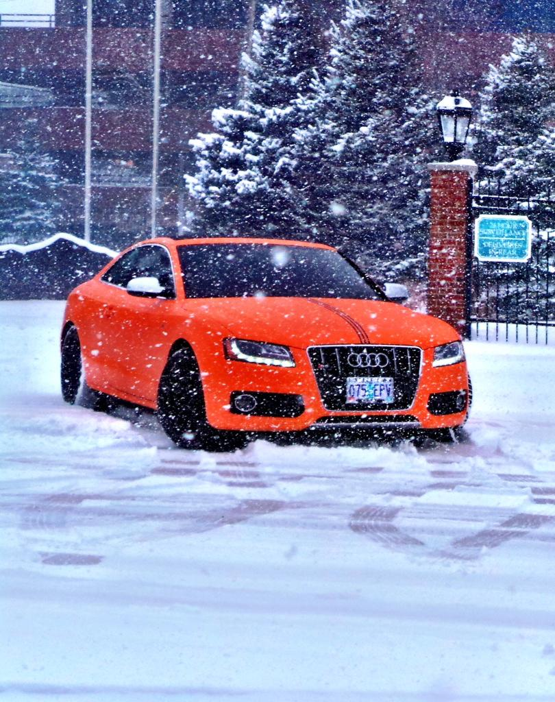 orange audi in snow