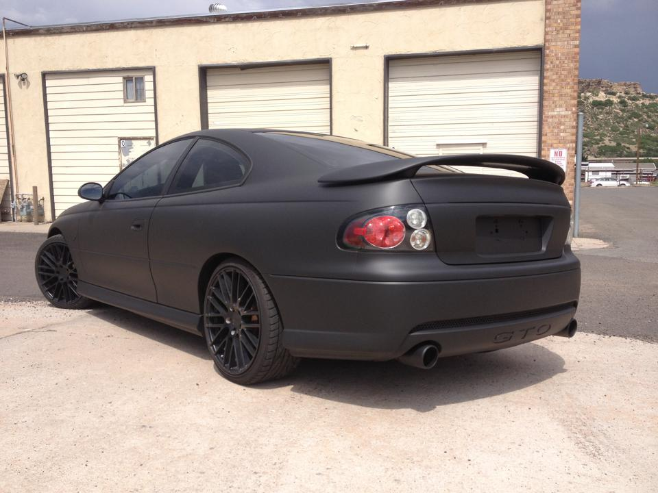flat black Pontiac wrap rear